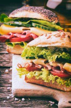 Fresh sandwiches on cutting board
