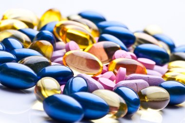 Colorful vitamin gel capsules isolated on whiteback ground