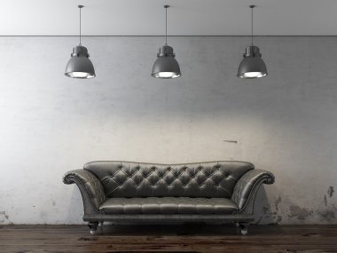 Black sofa in front of grunge wall