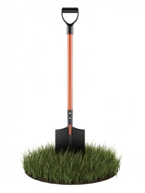 Shovel in green grass