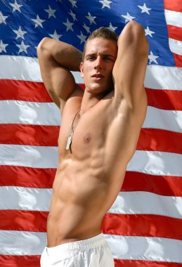Muscular Sexy Man with US Flag behind