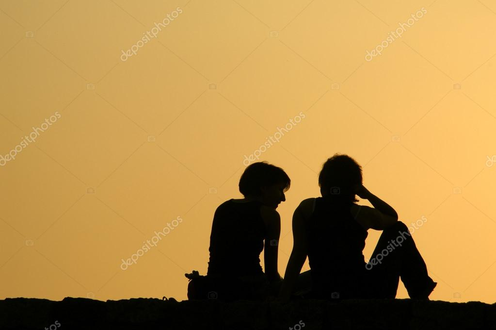 Two Girls Talking at Sunset