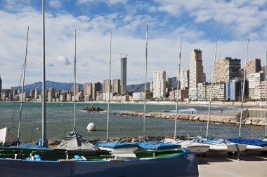 Moored boats with Benidorm as background