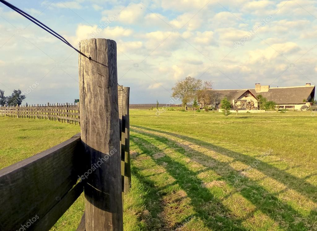A fence and a House in the Countryside