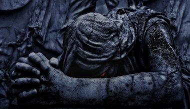 Statue of an Dark Angel Praying Close Up
