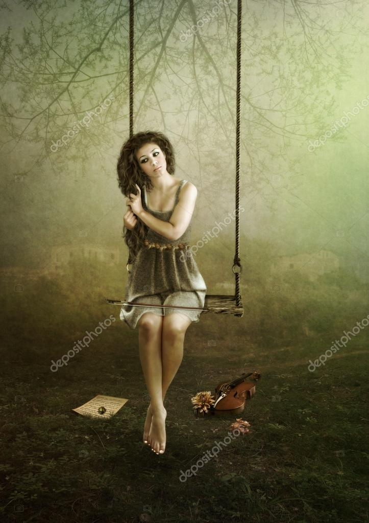 Young violinist on swing