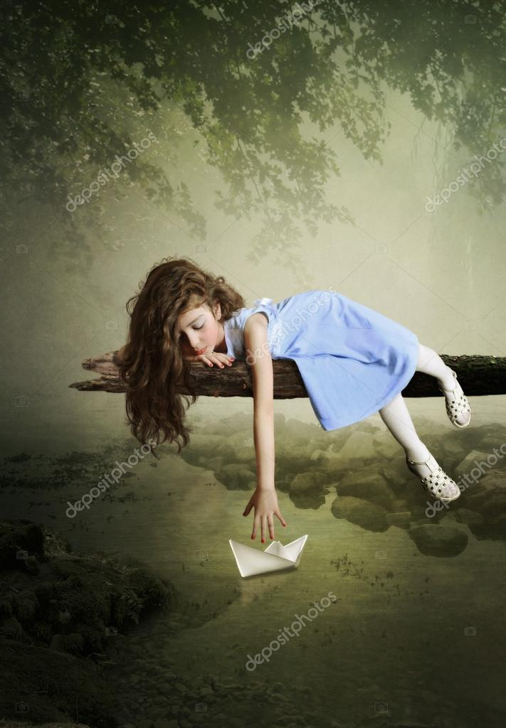 Girl and  paper boat