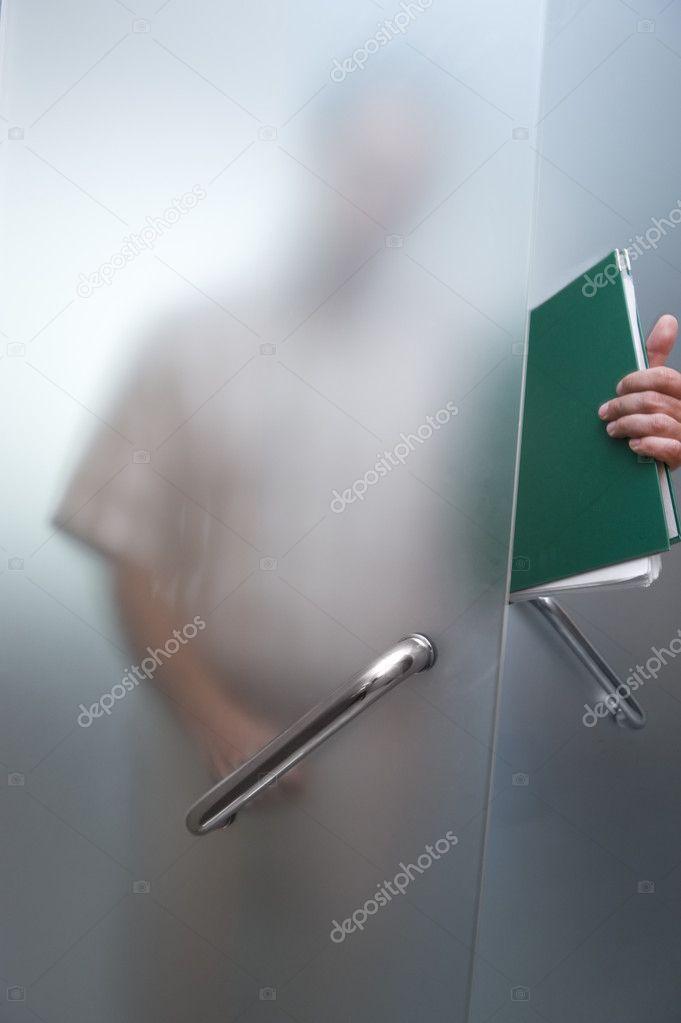 Businessman Walking Through The Glass Door Stock Photo Bork