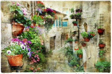 Charming floral streets in Spello, Umbria Italy, artistic pictur