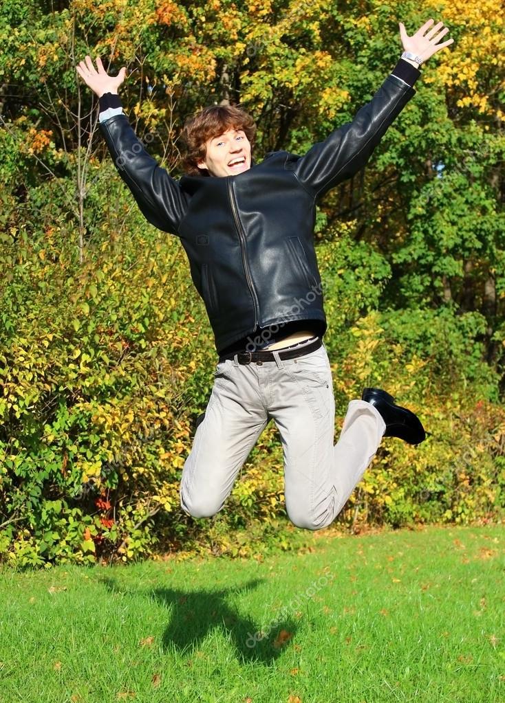 Joyful boy jumping