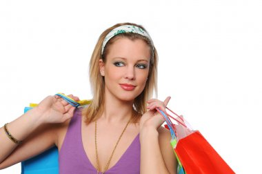 Beautitul teen girl with shopping bags
