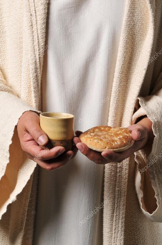 Jesus Holding A Bread And A Wine Stock Photo