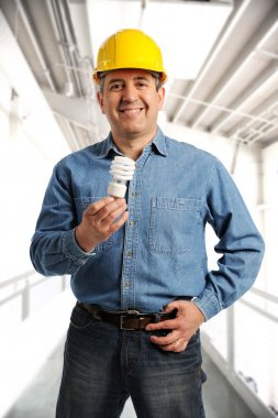 Engineer holding an electrical bulb