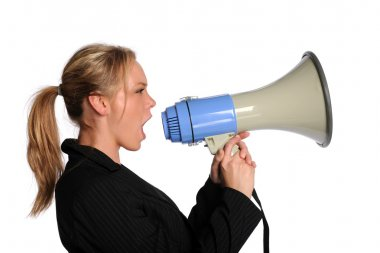 Young businesswoman screaming with a megaphone