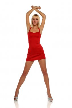 Young Blond Woman wearing a red dress