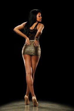 Young African American Woman wearing high heels and a mini skirt