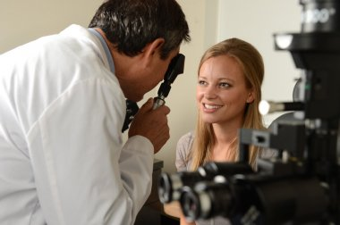 Eye Doctor with female patient