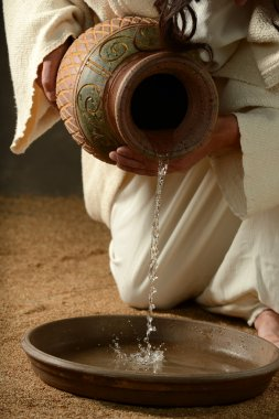 Detail of Jesus pouring water