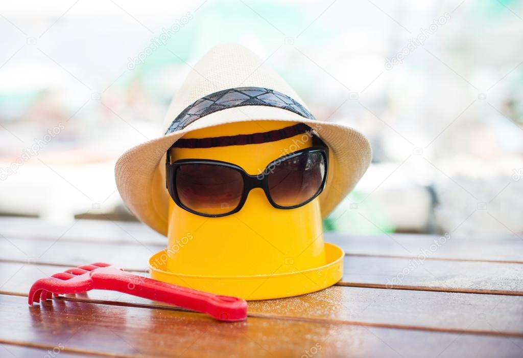 The Beach scene with bucket and sunglasses