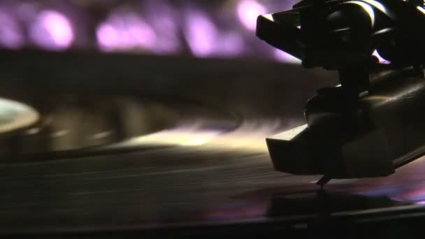 Record player. Violet light.