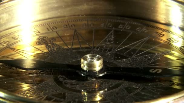 Golden compass closeup