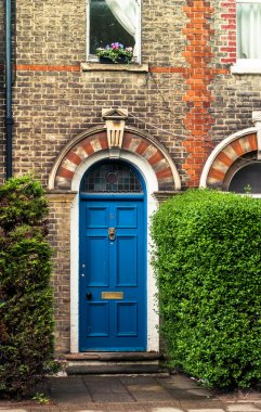 Arched blue door of victorian english house, UK
