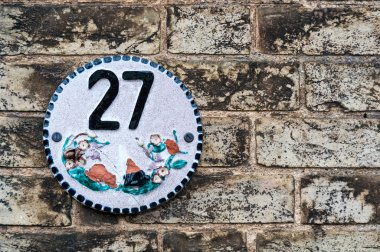 Number 27 on a brick wall for as a background