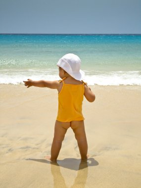 Kid back on the beach