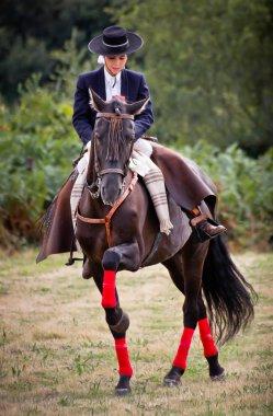 Flamenco woman riding a horse