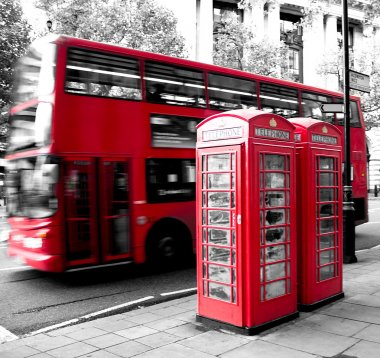 Red phone booth and red bus