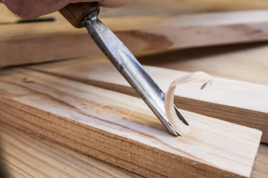 Gouge wood chisel carpenter tool working wooden background