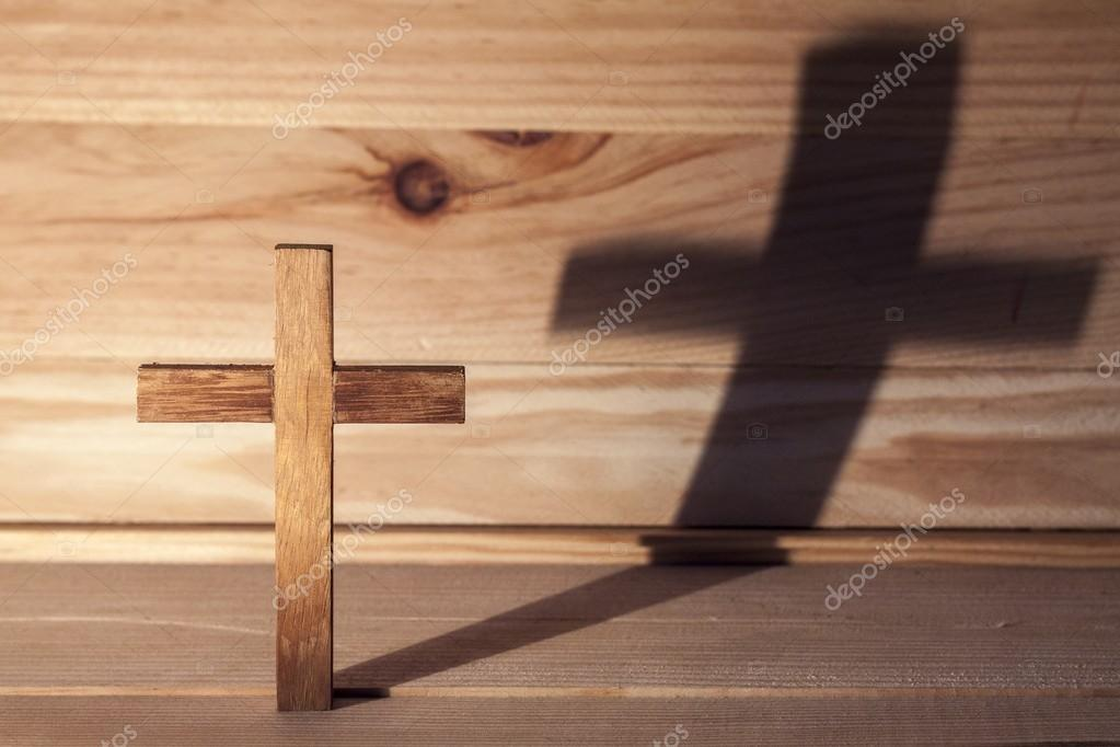 Cross over wood table with shadow stock vector