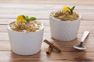 Creamy rice pudding sprinkled with cinnamon