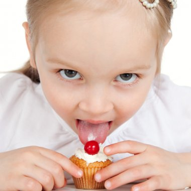 Closeup portrait of sweet little girl with cake