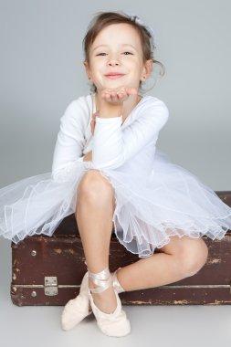 Beautiful little dancer, ballerina in white dress