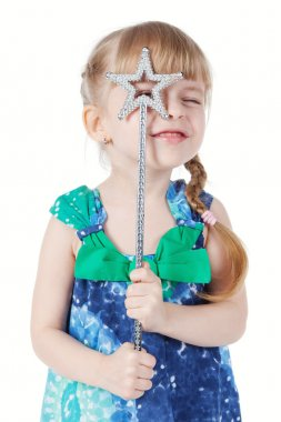 Portrait of a little girl with a magic wand