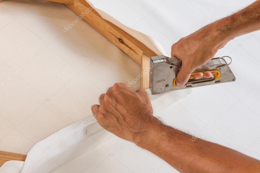 Artist stretching canvas