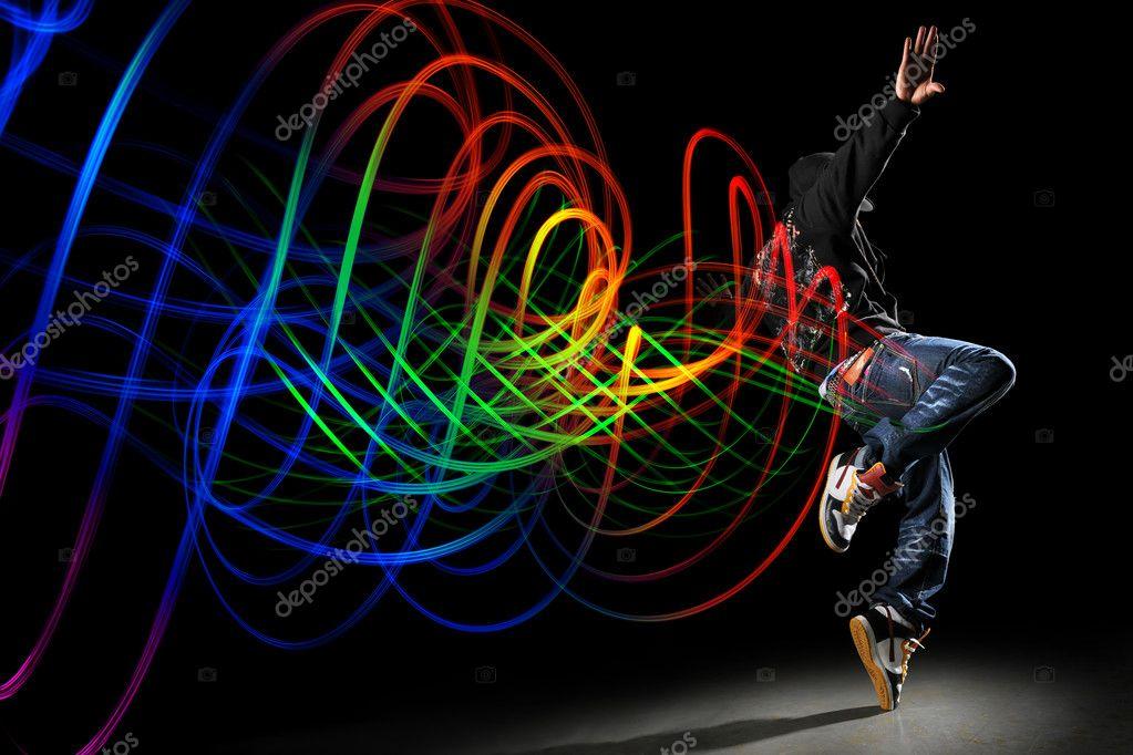 Dancer with Waves of Light Over Black Background