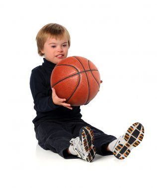 Boyy With Down Syndrome Playing With Ball