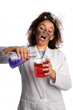 Young Scientisct Mixing Chemicals