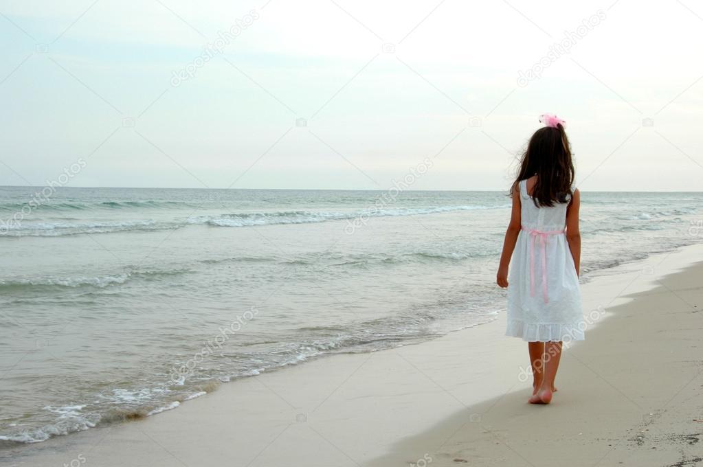 Girl Walking on Beach — Stock Photo © ginosphotos1 #16641021