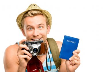 Happy young tourist man holding passport retro camera white back