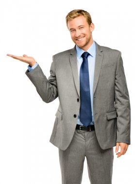 Happy young businessman showing empty copyspace on white background stock vector