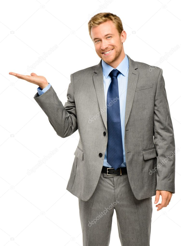 Happy young businessman showing empty copyspace on white backgro