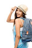 Docela indiánka turistické výkonu izolovaných na bílém batoh