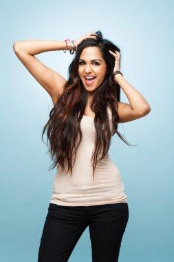 Closeup Indian cute teenage girl posing for camera blue backgrou