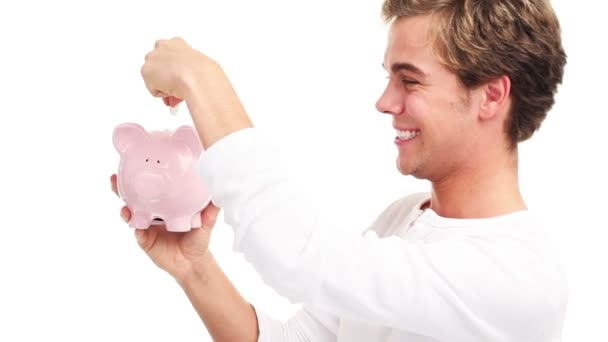 Rich man is happy counting his money, saving using a piggy-bank - isolated on white
