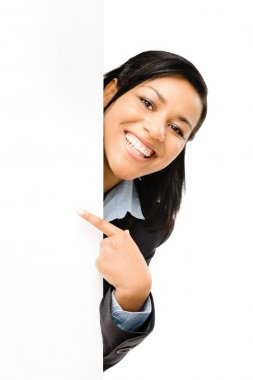 Happy mixed race business woman pointing at empty copy space iso