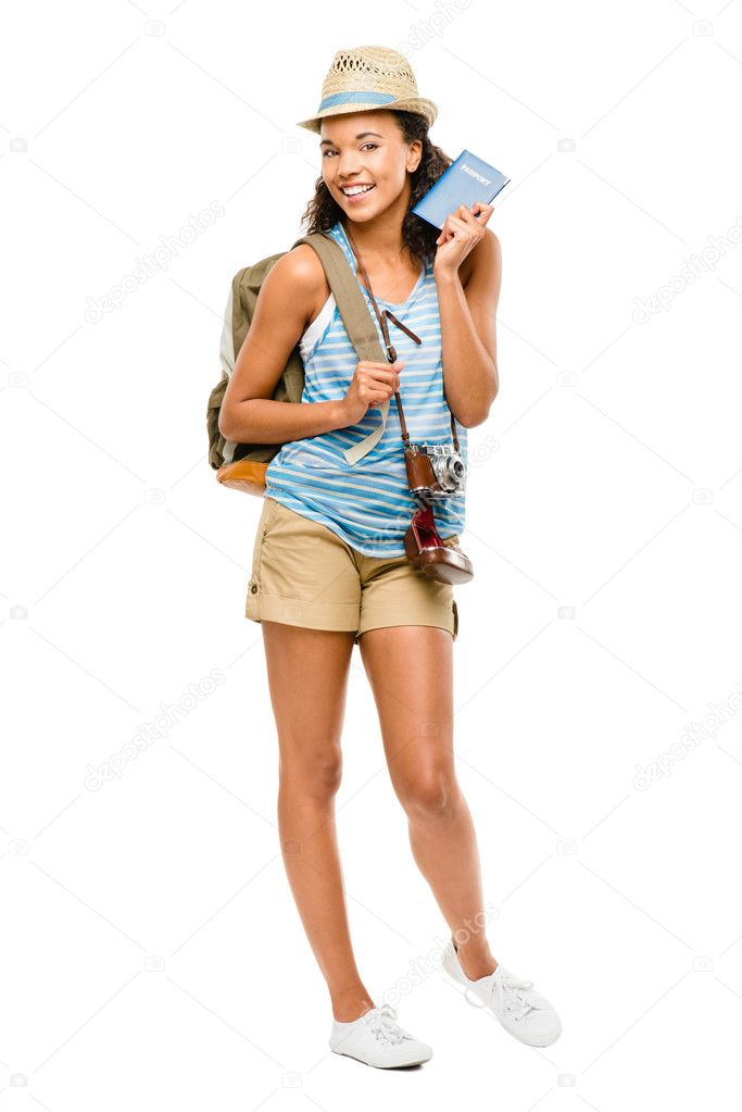 Happy African American woman tourist holding passport