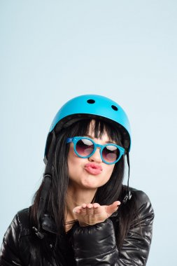 funny woman wearing cycling helmet portrait real